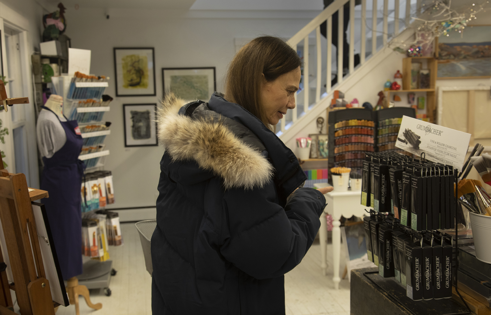Claire (Lena Olin) shops for art supplies for herself in THE ARTIST'S WIFE. Photo by Michael Lavine.