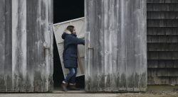 Claire (Lena Olin) enters her new barn studio in THE ARTIST'S WIFE. Photo by Michael Lavine.
