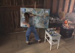 Claire (Lena Olin) painting in her barn studio in THE ARTIST'S WIFE. Photo by Michael Lavine.