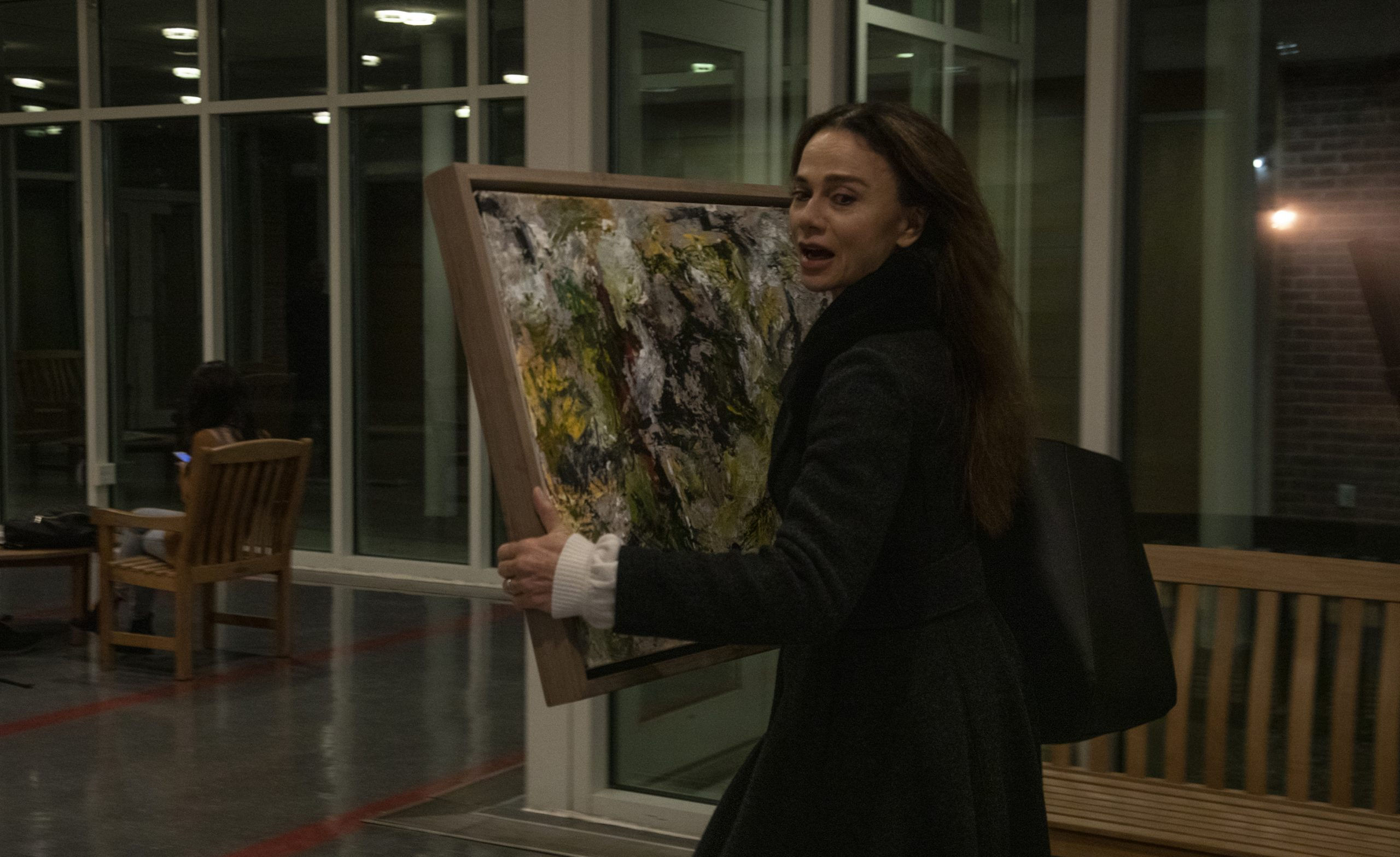 Claire (Lena Olin) takes back one of Richard's paintings from the college in THE ARTIST'S WIFE. Photo by Michael Lavine.