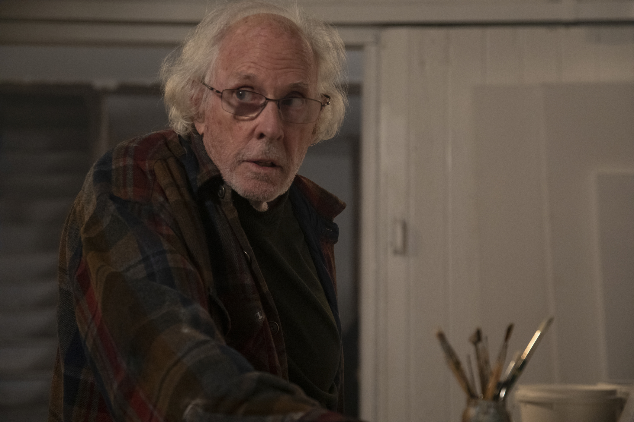 Richard (Bruce Dern) in his studio in THE ARTIST'S WIFE. Photo by Michael Lavine.