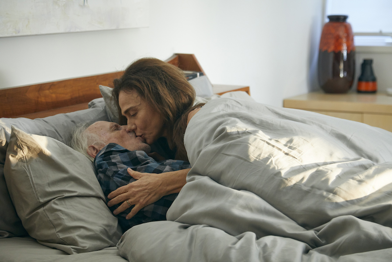 Richard (Bruce Dern) and Claire (Lena Olin) share an intimate moment in THE ARTIST'S WIFE. Photo by Michael Lavine.