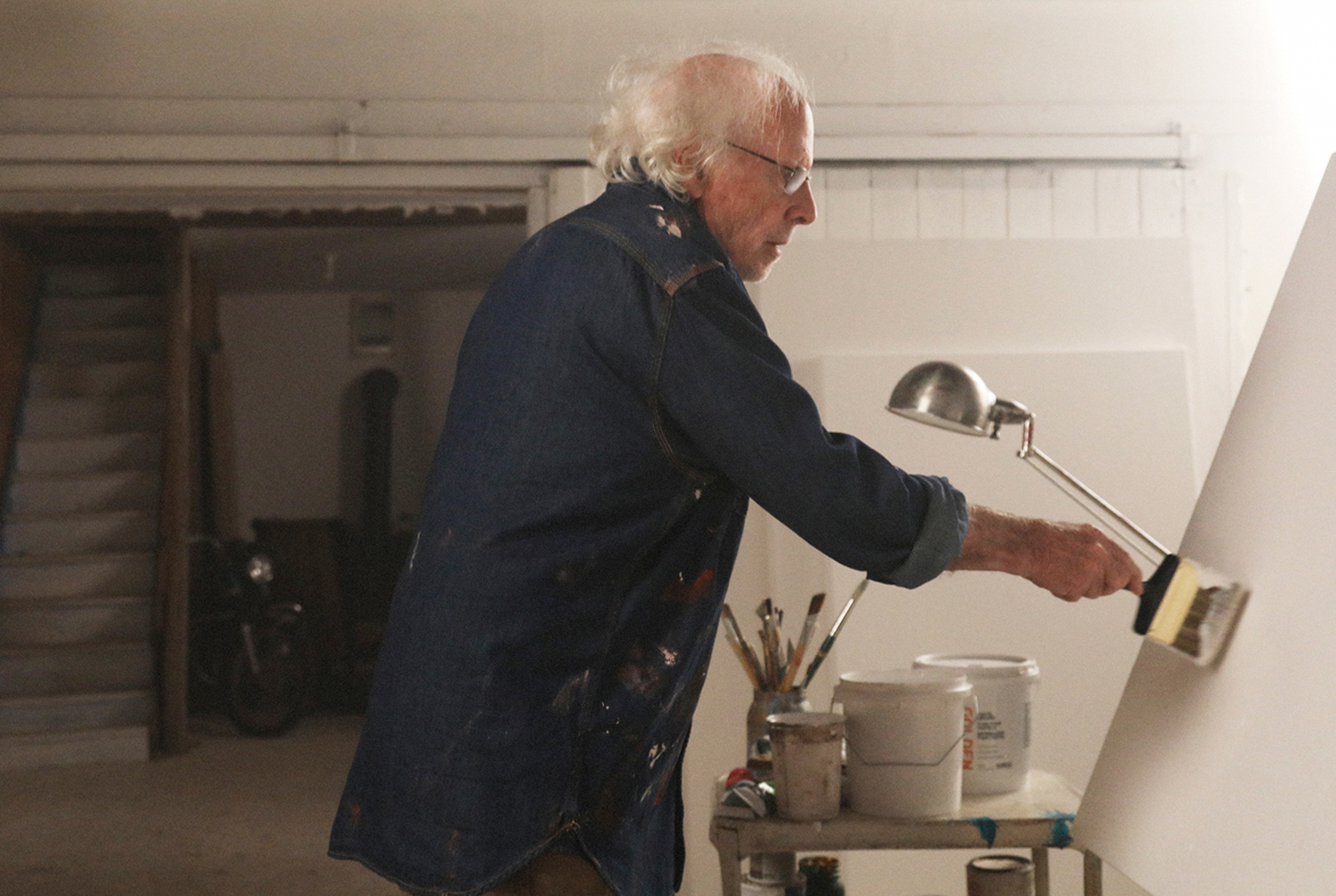Richard (Bruce Dern) works in his studio in THE ARTIST'S WIFE. Photo by Michael Lavine.