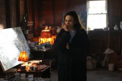 Claire (Lena Olin) thinks about her next move in her barn studio in THE ARTIST'S WIFE. Photo by Michael Lavine.