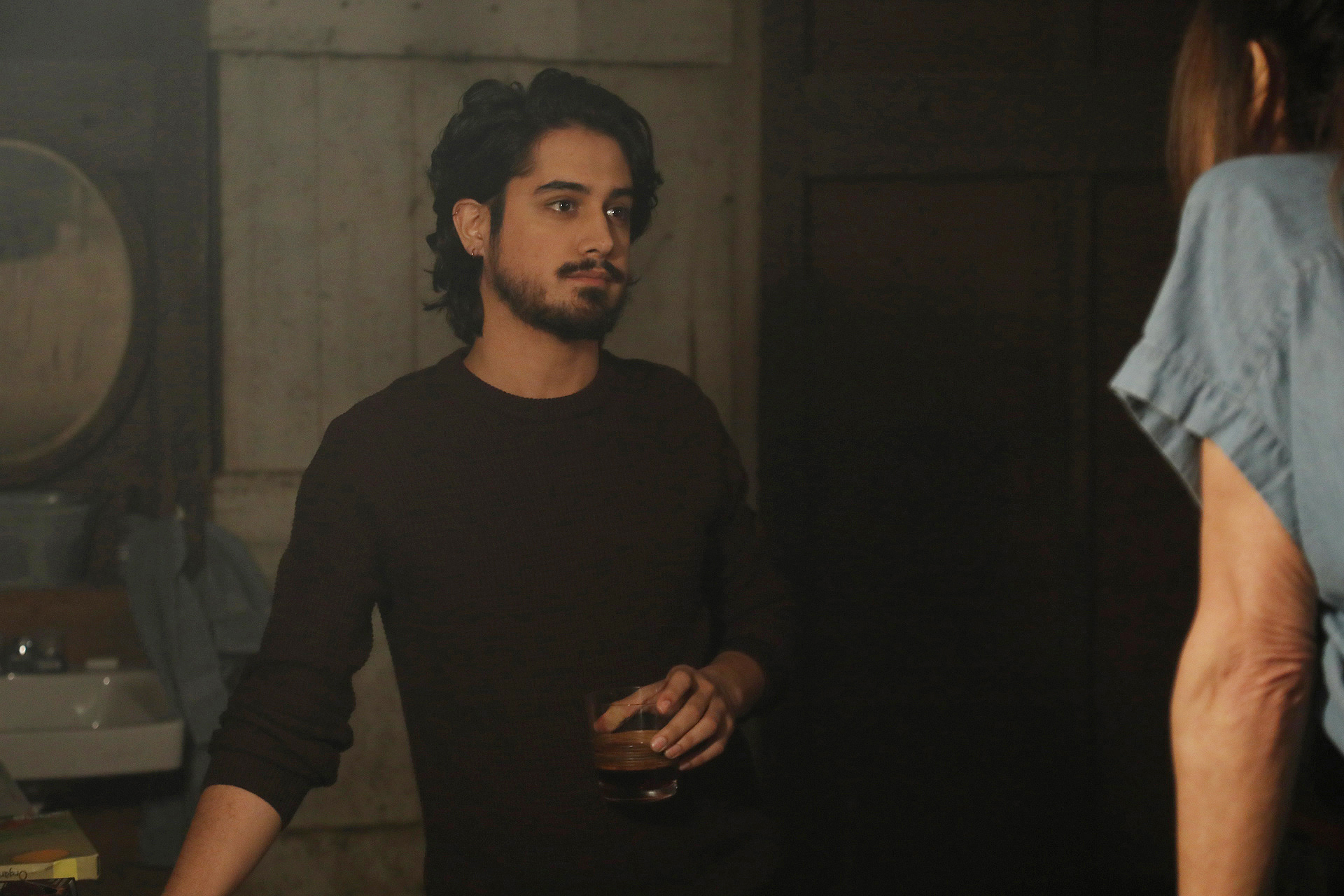 Danny (Avan Jogia) confides in Claire (Lena Olin) in her barn studio in THE ARTIST'S WIFE. Photo by Michael Lavine.