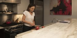 Claire (Lena Olin) prepares dinner—and finding unexpected inspiration—in THE ARTIST'S WIFE. Photo by Michael Lavine.