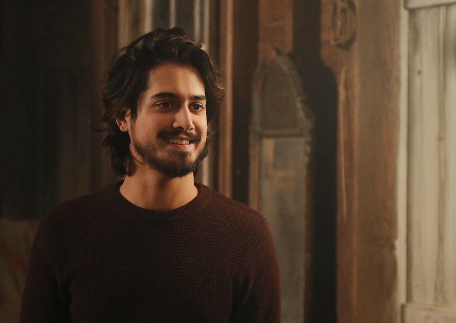 Danny (Avan Jogia) in Claire's barn studio in THE ARTIST'S WIFE. Photo by Michael Lavine