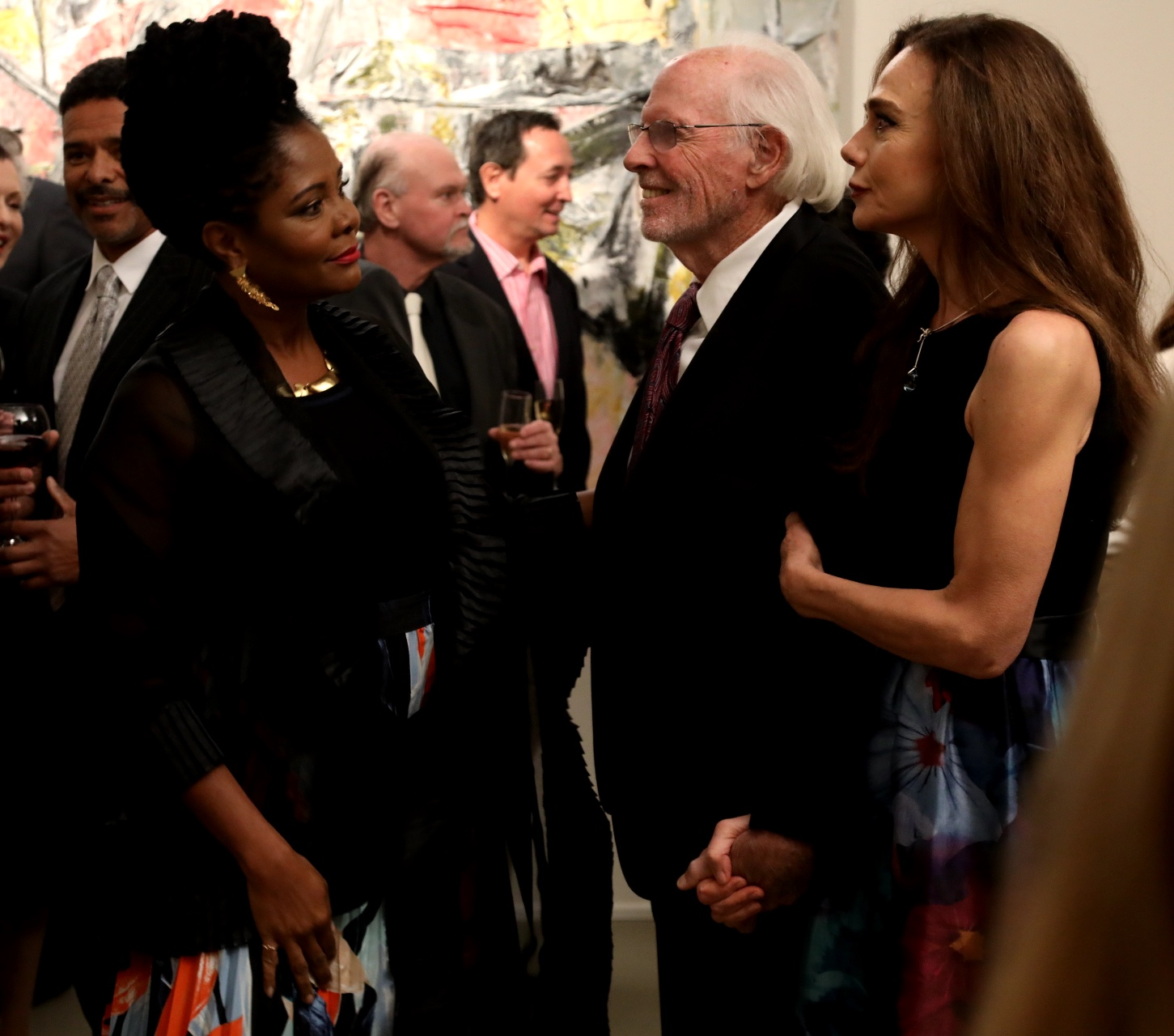 Liza (Tonya Pinkins) greets Richard (Bruce Dern) and Claire (Lena Olin) at his art opening at her gallery in THE ARTIST'S WIFE. Photo by Michael Lavine